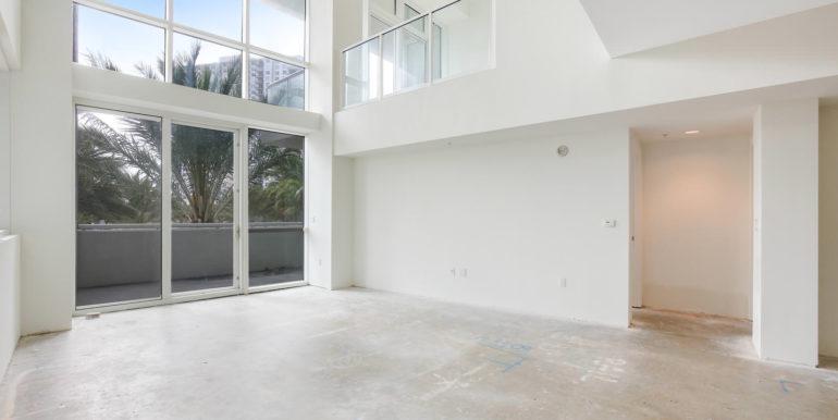1-n-ocean-blvd-unit-205-large-003-17-living-room-1500x1000-72dpi
